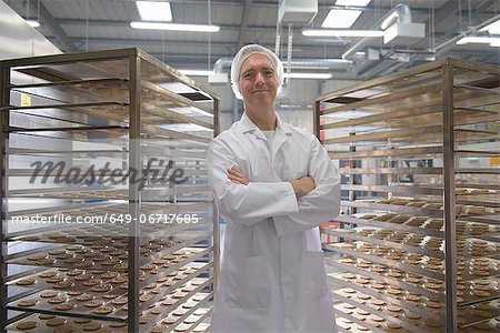 Worker baking biscuits in factory Stock Photo - Premium Royalty-Free, Image code: 649-06717685