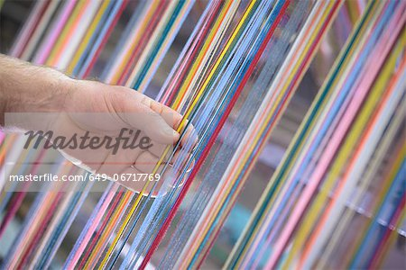 Colorful yarn on loom in textile mill Stock Photo - Premium Royalty-Free, Image code: 649-06717769