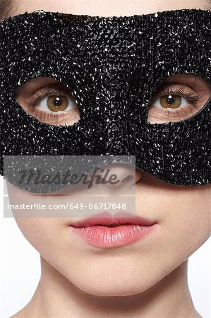 Woman wearing glitter mask over eyes Stock Photo - Premium Royalty-Free, Image code: 649-06717848