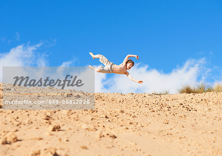 Boy jumping on beach Stock Photo - Premium Royalty-Free, Image code: 649-06812028