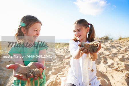 Two girls playing with sand Stock Photo - Premium Royalty-Free, Image code: 649-06812051