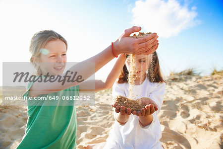 Two girls playing with sand Stock Photo - Premium Royalty-Free, Image code: 649-06812052