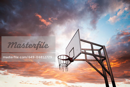 Basketball hoop and dramatic sky Stock Photo - Premium Royalty-Free, Image code: 649-06812729