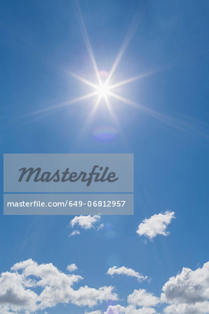 Fluffy clouds blue sky and sunlight Stock Photo - Premium Royalty-Free, Image code: 649-06812957