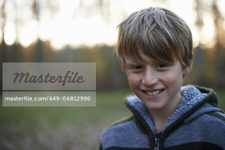 Portrait of boy in forest Stock Photo - Premium Royalty-Free, Image code: 649-06812990