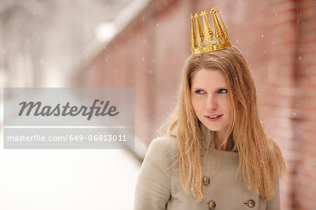 Woman wearing crown with brick wall behind her Stock Photo - Premium Royalty-Free, Image code: 649-06813011