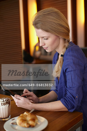 Woman using digital tablet Stock Photo - Premium Royalty-Free, Image code: 649-06813032