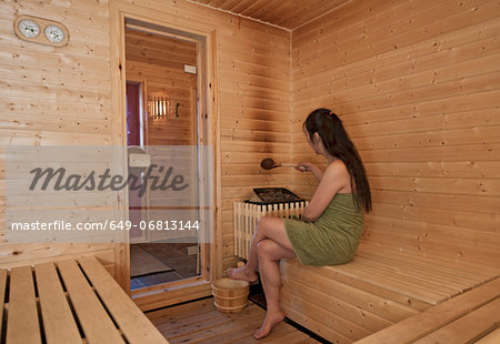Woman in sauna Stock Photo - Premium Royalty-Free, Image code: 649-06813144