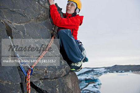 Woman rock climbing, Svinafellsjokull glacier, Skaftafell national park, Iceland Stock Photo - Premium Royalty-Free, Image code: 649-06813152