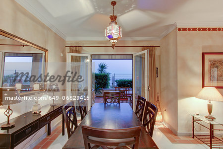 Luxury dining room in wealthy home Stock Photo - Premium Royalty-Free, Image code: 649-06829415
