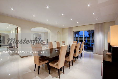 Luxury dining room in wealthy home Stock Photo - Premium Royalty-Free, Image code: 649-06829419