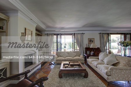Luxury living room in wealthy home Stock Photo - Premium Royalty-Free, Image code: 649-06829430