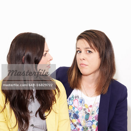 Young women arguing against white background Stock Photo - Premium Royalty-Free, Image code: 649-06829722