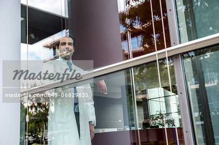 Portrait of male doctor inside hospital Stock Photo - Premium Royalty-Free, Image code: 649-06829835