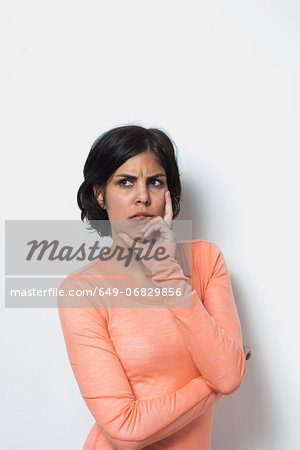 Portrait of young female grimacing Stock Photo - Premium Royalty-Free, Image code: 649-06829856
