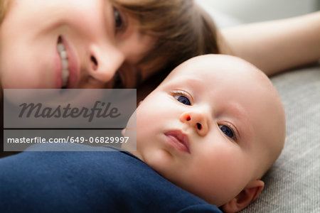 Portrait of mother with baby son lying down, close up Stock Photo - Premium Royalty-Free, Image code: 649-06829997
