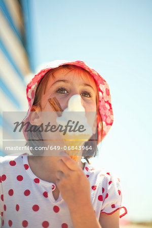 Little girl enjoying an ice cream Stock Photo - Premium Royalty-Free, Image code: 649-06843964