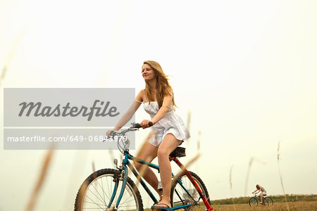 Girl riding bike Stock Photo - Premium Royalty-Free, Image code: 649-06843979