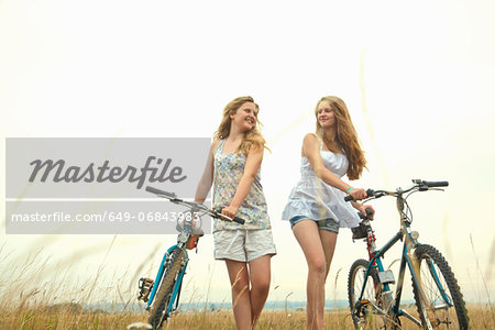 Girls with bikes Stock Photo - Premium Royalty-Free, Image code: 649-06843983