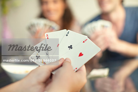 People playing cards Stock Photo - Premium Royalty-Free, Image code: 649-06844007