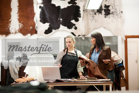 Worker and customer in leather workshop Stock Photo - Premium Royalty-Free, Image code: 649-06844097