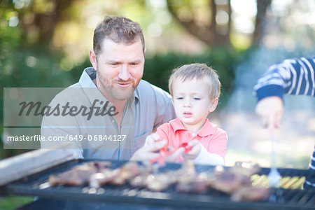 Father and sons barbecuing Stock Photo - Premium Royalty-Free, Image code: 649-06844127