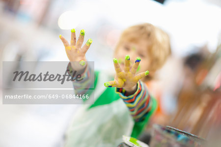 Boy with paint on his hands Stock Photo - Premium Royalty-Free, Image code: 649-06844166