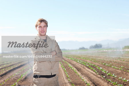 Young man in potato field, portrait Stock Photo - Premium Royalty-Free, Image code: 649-06844232