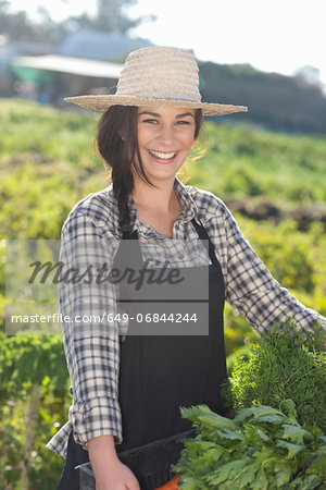 Young woman with vegetables grown at farm Stock Photo - Premium Royalty-Free, Image code: 649-06844244