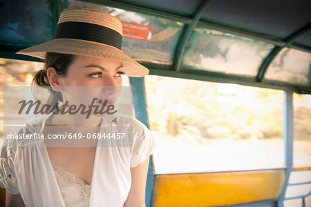 Woman wearing hat on rickshaw Stock Photo - Premium Royalty-Free, Image code: 649-06844457