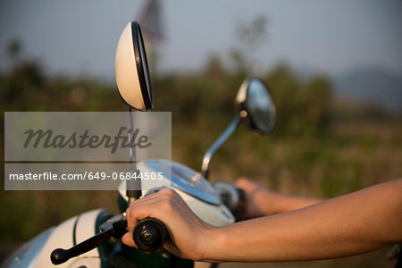 Woman's hands on moped handlebars Stock Photo - Premium Royalty-Free, Image code: 649-06844505