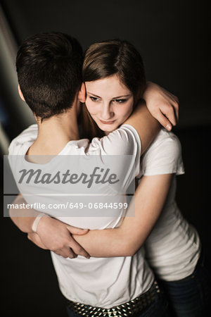 Teenage couple hugging Stock Photo - Premium Royalty-Free, Image code: 649-06844599