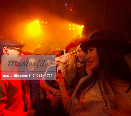 Group of people at party, man kissing woman's neck Stock Photo - Premium Royalty-Free, Image code: 649-06844727