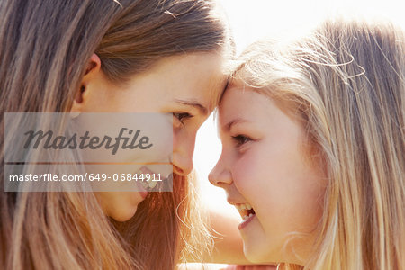 Children touching foreheads Stock Photo - Premium Royalty-Free, Image code: 649-06844911