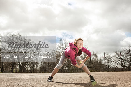 Woman doing stretching exercise Stock Photo - Premium Royalty-Free, Image code: 649-06844937