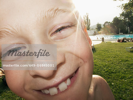 Boy with wet face smiling, portrait Stock Photo - Premium Royalty-Free, Image code: 649-06845001