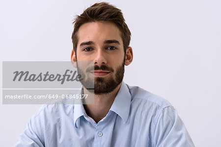 Close up portrait of young man in blue shirt Stock Photo - Premium Royalty-Free, Image code: 649-06845177