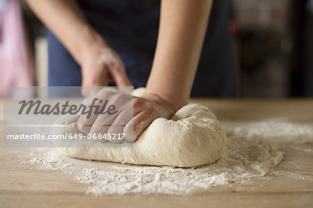 Hands kneading bread dough Stock Photo - Premium Royalty-Free, Image code: 649-06845217