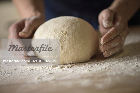 Close up of hands shaping bread dough Stock Photo - Premium Royalty-Free, Image code: 649-06845219