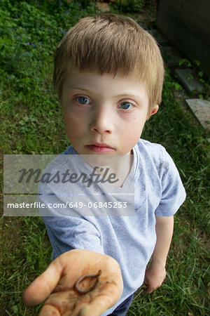 Close up portrait of boy with a worm in his hand Stock Photo - Premium Royalty-Free, Image code: 649-06845253