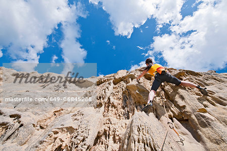 Female rock climber nearing cliff top Stock Photo - Premium Royalty-Free, Image code: 649-06845288
