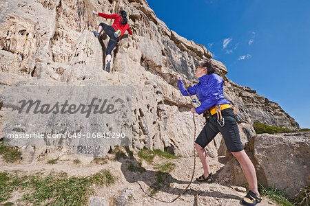 Female rock climbers near cliff base Stock Photo - Premium Royalty-Free, Image code: 649-06845290