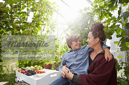 Mother and son sitting outdoors Stock Photo - Premium Royalty-Free, Image code: 649-06943770