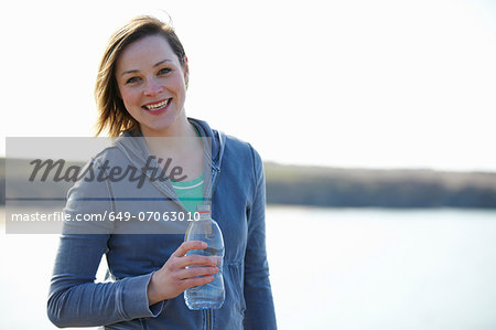 Portrait of young woman at coast taking exercise break Stock Photo - Premium Royalty-Free, Image code: 649-07063010