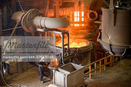 Elevated view of steel worker and furnace in steel foundry Stock Photo - Premium Royalty-Free, Image code: 649-07063069