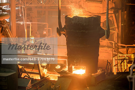 Elevated view of steel worker and molten bucket in steel foundry Stock Photo - Premium Royalty-Free, Image code: 649-07063070