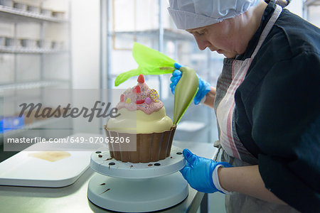 Chocolatier icing giant size cup cake Stock Photo - Premium Royalty-Free, Image code: 649-07063206