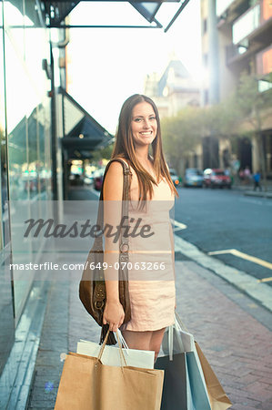 Portrait of young woman with shopping bags Stock Photo - Premium Royalty-Free, Image code: 649-07063266