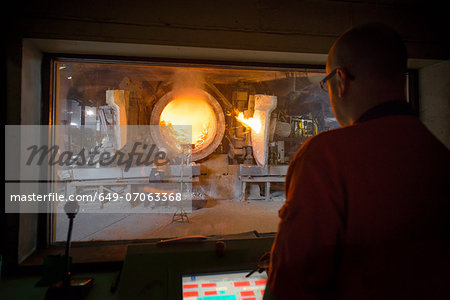 Monitoring furnace at aluminum recycling plant Stock Photo - Premium Royalty-Free, Image code: 649-07063368