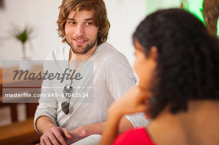 Young couple talking in cafe Stock Photo - Premium Royalty-Free, Image code: 649-07063524